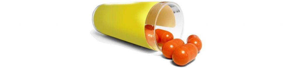 orange Tabletten in einem gelben Becher, Credit: Andreas Ilgmeier, Pixabay
