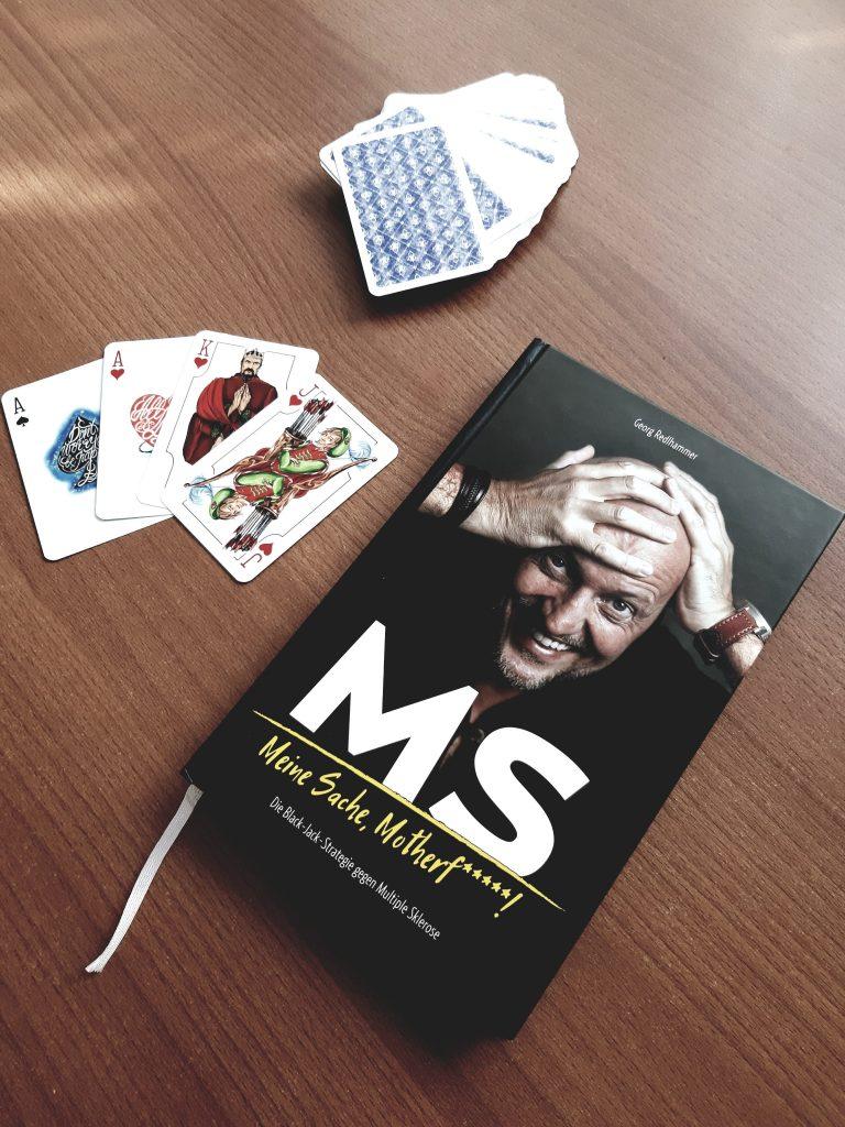 Das Buch inklusive Kartenset